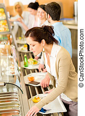 Business woman choose cafeteria lunch buffet carry serving...