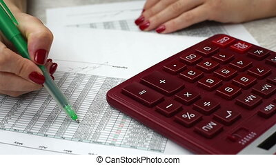 Business woman counts annual report, close up