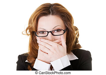Business woman covering her mouth.