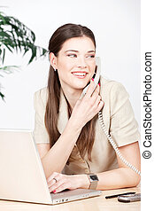 woman doing phone call in the office
