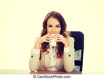 Business woman drinking coffee.