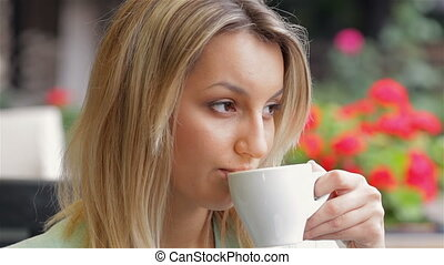 Business woman drinking coffee in a cafe