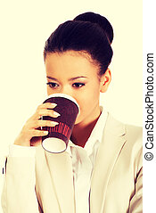 Business woman drinking coffee.