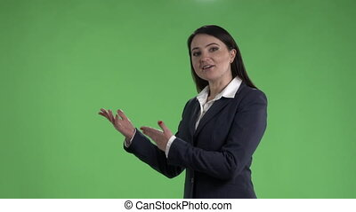 Business woman during presentation against a green screen