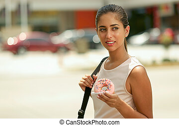 Business Woman Eating Donut For Breakfast Commuting To Work