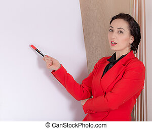 Business woman explaining at the whiteboard.