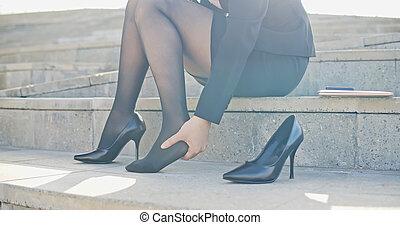 business woman feel foot pain