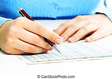Business woman filling document.