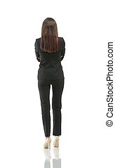 Business woman from the back - looking at something over a white