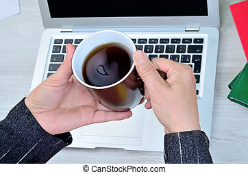 woman hand hold a cup of coffee