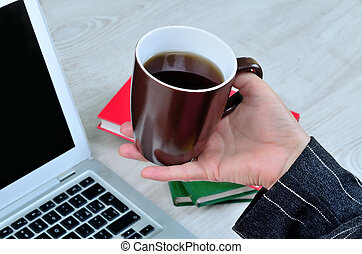 business woman hand hold a cup of coffee