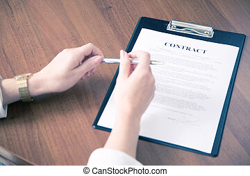 Business woman hands on contract