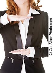 Business woman having hands in front of her belly,empty space.