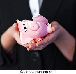 Business woman holding a broken piggy bank - Young Business...