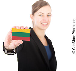 business woman holding a card with the flag of Lithuania