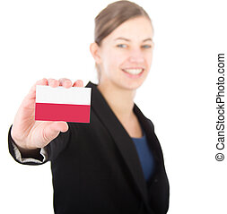 business woman holding a card with the flag of Poland