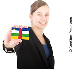 business woman holding a card with the flag of the Central African Republic. With focus on the card