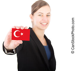 business woman holding a card with the Turkish flag