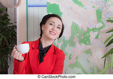 Business woman holding a cup.