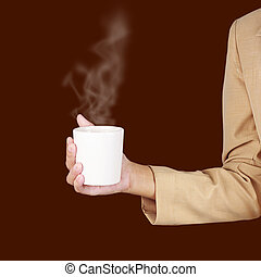 Business woman holding a cup of coffee in hand.