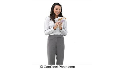 Business woman holding a fan of cash in her hands