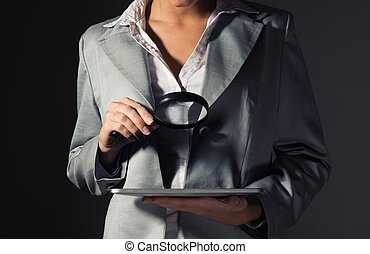 business woman holding a magnifying glass - business woman...