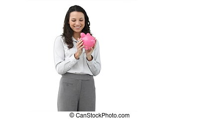 Business woman holding a piggy-bank against a white...