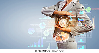 Business woman holding alarmclock - Image of businesswoman...