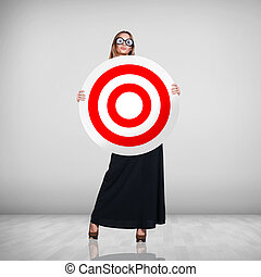 Business woman holding big target
