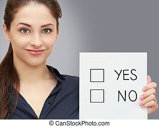 Business woman holding blank with option yes or no on grey...