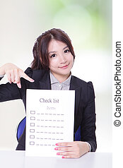 Business woman holding checklist paper