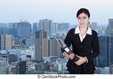 business woman holding folder documents with city