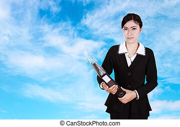 business woman holding folder documents with sky