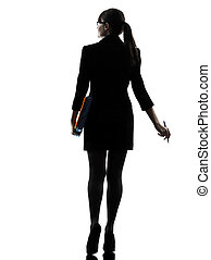 business woman  holding folders files leaving silhouette