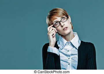 Business woman holding her glasses and looking up