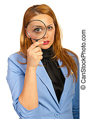 Business woman holding magnifier