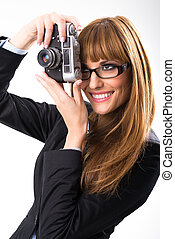 Business woman holding old camera