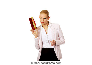 Business woman holding present box