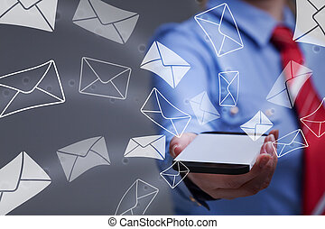 Business woman holding smartphone sending mail