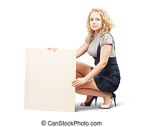 woman holds blank canvas