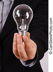 Business Woman Holds Lightbulb