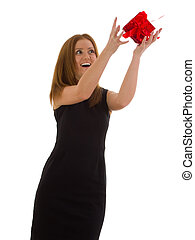 Business woman in a black dress catches a gift