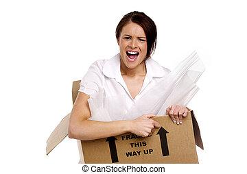 Business woman in a cardboard box