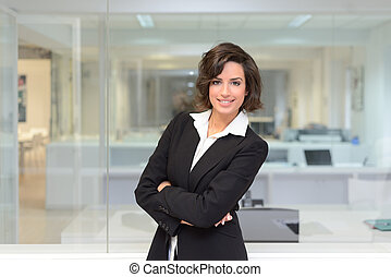 Business woman in a office. Crossed arms
