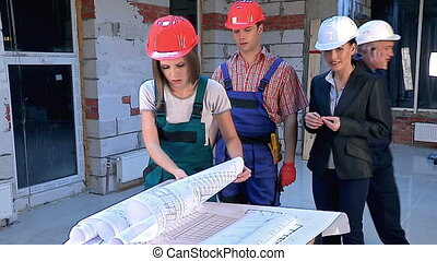 Business woman in builder helmet . - Group people of workers...