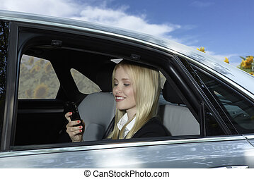 Business Woman in car with mobile phone