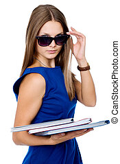 Business woman in dark glasses with a folder for documents