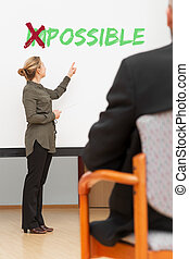 business woman in front of a canvas with the word possible