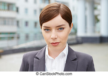 Business Woman in front of office building.