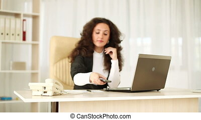 Business woman in office talking